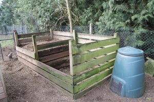 some of our compost bins - the chickens scratch through them