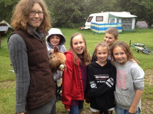 Me, dead chicken and kids in the rain just before the autopsy