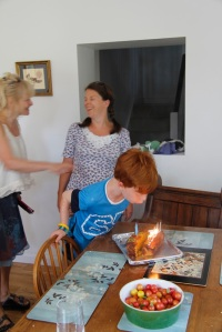Blowing out candles on the Rainbow Loom lemon and orange polenta  cake