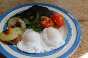 Fried blood cake with poached duck eggs