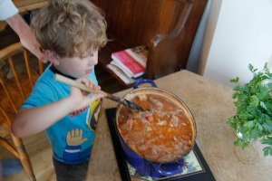 Luka stirring the stew just before we ate it
