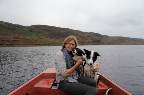 me and dogs on boat
