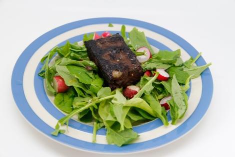 black pudding on salad