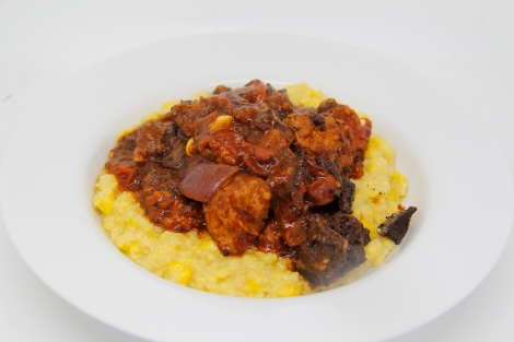Sweetcorn polenta with sausage and blackpudding ragout